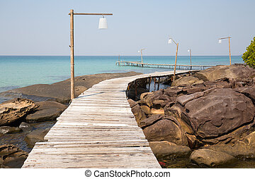 Wooden pier on the beautiful tropical beach in island Koh...