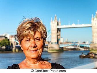 Happy woman relaxing in London