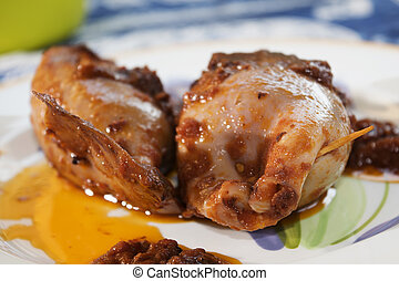 stuffed calamari with tomato sauce - stuffed and stirfried...