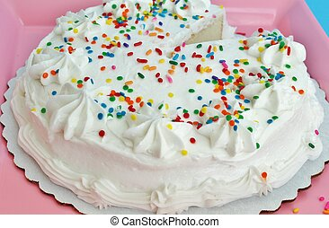 Cake with sprinkles - Cake with white frosting and sprinkles