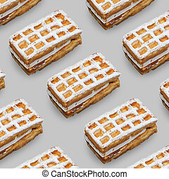 Viennese waffles with powdered sugar on a gray background.