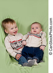 Baby Boys in Winter Clothes - A portrait of two baby boys...