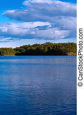 Lake summer view with reflection of clouds on water, Finland...