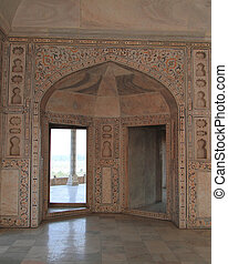 decorated arch entrance in Agra fort