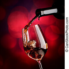 Wine on vinous background - Wine pouring in wineglass on a...