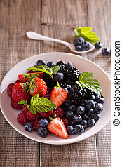 Variety of summer berries on a plate