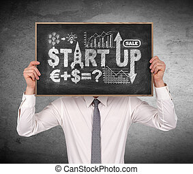 start up - businessman standing in office and holding...