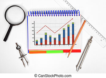 notepad with chart on the desktop engineer