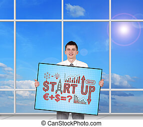 start up - businessman holding plasma panel with start up