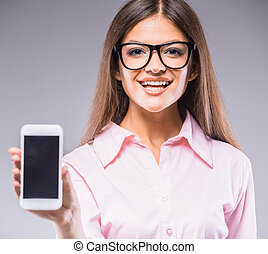 Beauty woman - Beautiful young woman in glasses holding...