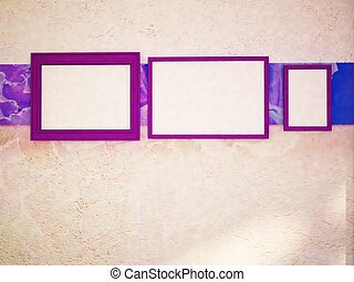 three violet frames on the wall,