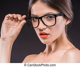 Beauty woman - Smart beauty Young serious shirtless woman in...