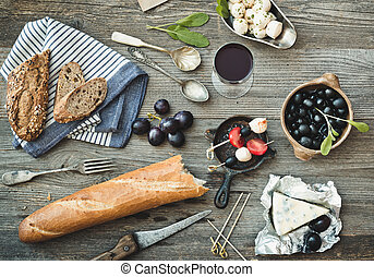 French cuisine. Different types of cheese, wine and other...