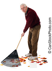 Tired of Yard Work - A senior man raking colorful fall...