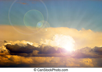 beautiful sun behind the clouds with lens flare, cloudscape