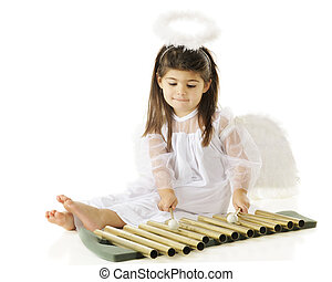 "Angel Chimes - A beautiful preschool-aged ""angel"" playing..."