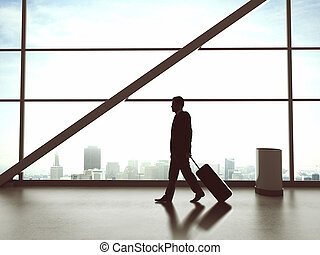 businessman walking in airport - young businessman walking...