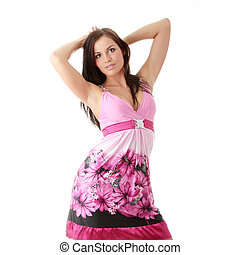 Woman in pink dress with orthodontic appliance