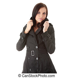 Fashion model in black coat