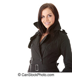 Fashion model in black coat with orthodontic appliance over...