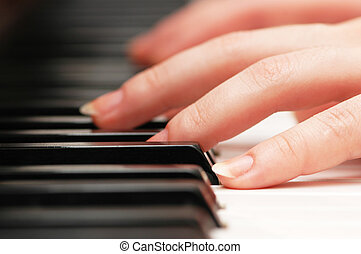 Two hands playing music on the  piano