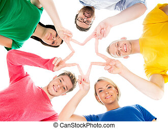 Happy students in colorful clothing standing together making...
