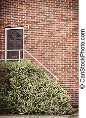 Front door of red brick house