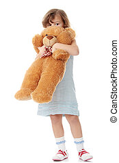 Portrait of a 5 year old girl with teddy bear isolated on...