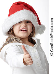Portrait of a 5 year old girl in santa hat isolated on white...