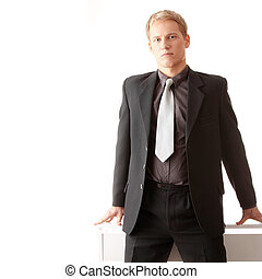 Young businessman siting on desk