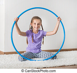 smiling girl with hula hoop at home - smiling girl with hula...