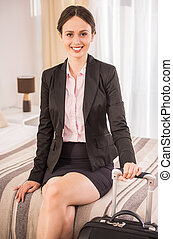 Business Trip - Attractive business woman looking at camera...
