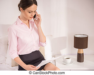 Business Trip - Confident business woman talking by phone...