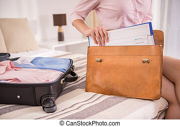 Business Trip - Business woman packing his things into the...