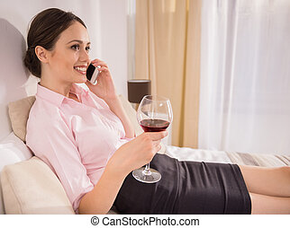 Business Trip - Cheerful business woman talking by phone and...