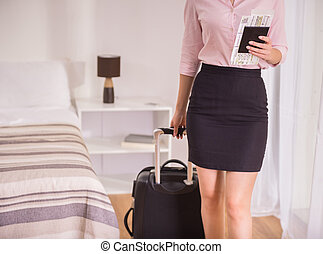 Business Trip - Business woman with her documents and...