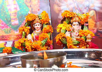 goddess lakshmi and lord ganesha statue, pray concept -...