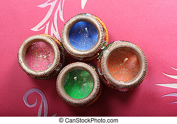 Beautiful multicolored diya candles for diwali celebration