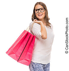 Shopping - Cheerful woman in glasses holding colored...