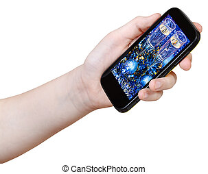 hand holds smart phone with Xmas still life on screen...