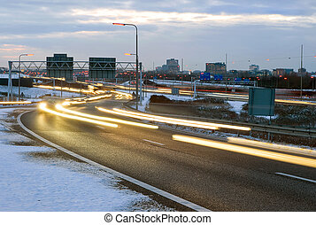 Winter traffic - Cars passing by on a motorway junction on a...
