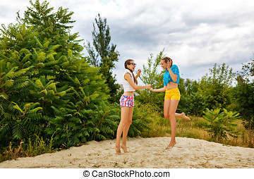 Best girlfriends have fun in the sand.