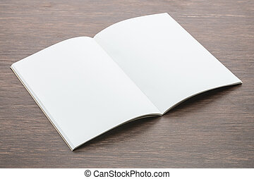 Blank paper mock up on wood background