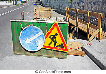 Road work - Sign and fence on road construction work