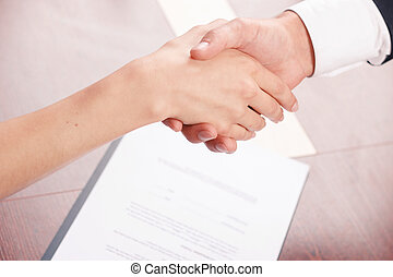 Colleagues shaking hands - Come to agreement. Close up of...