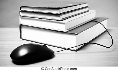 book and computer mouse black and white color tone style -...