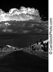 Storm Clouds Over Town - Large thunderstorm approaching a...