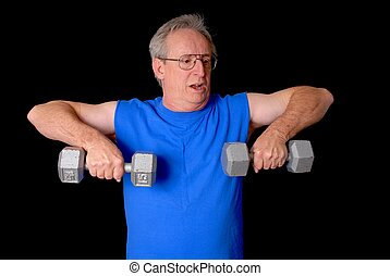 Senior Fitness - Senior citizen fitness training by lifting...