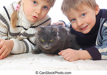 meet our pussy-cat - two kids lying on the floor with their...