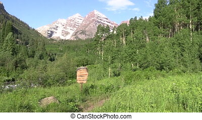 Hiking to the Maroon Bells - a hiker on a trail to the...